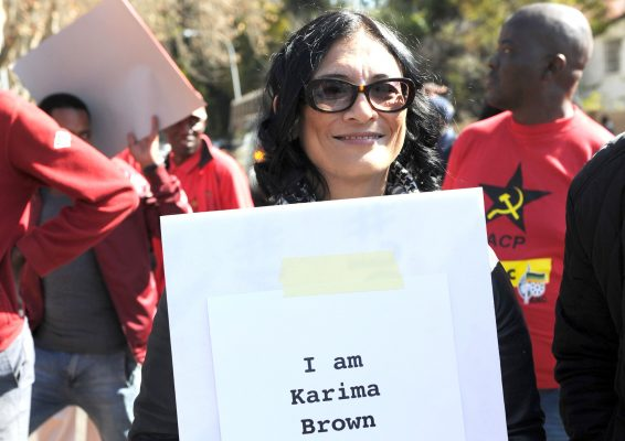 """Karima Brown during the protest against SABC COO Hlaudi Motsoeneng outside the Auckland studios on July 06, 2016 in Johannesburg, South Africa. The SACP lashed out at Motsoeneng for using the 90% local quota to """"divide workers in the creative industries and to sow confusion among the public"""". (Photo by Gallo Images / Beeld / Felix Dlangamandla)"""