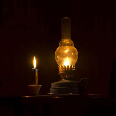71705898 - kerosene lamp and candles flicker in the dark warm light